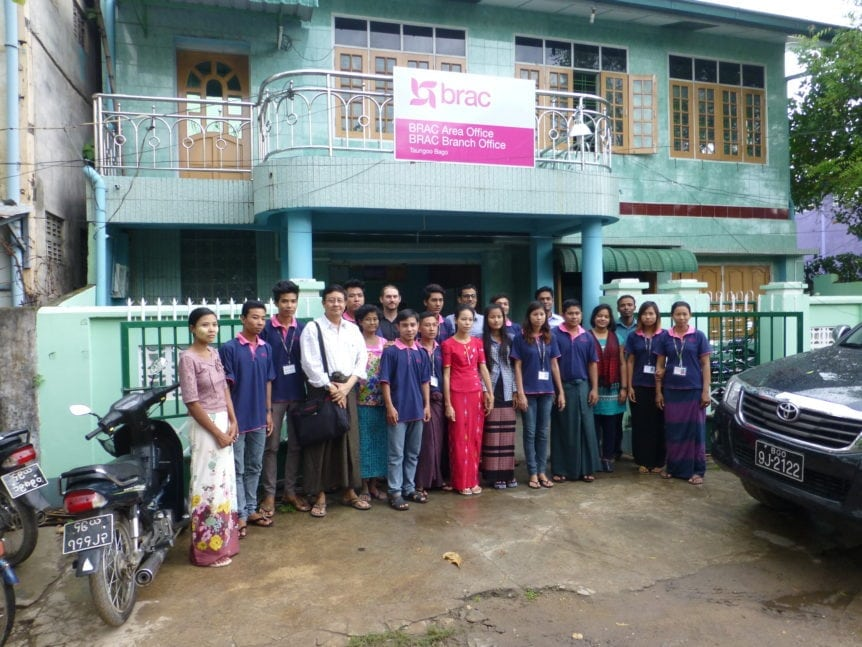 staff at BRAC myanmar standing in front of the branch office