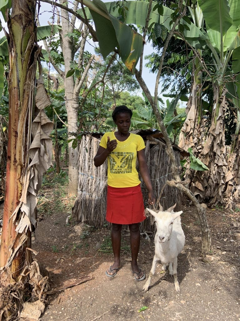 a woman with her goat