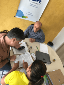 people sitting around a table in a microfinance institution