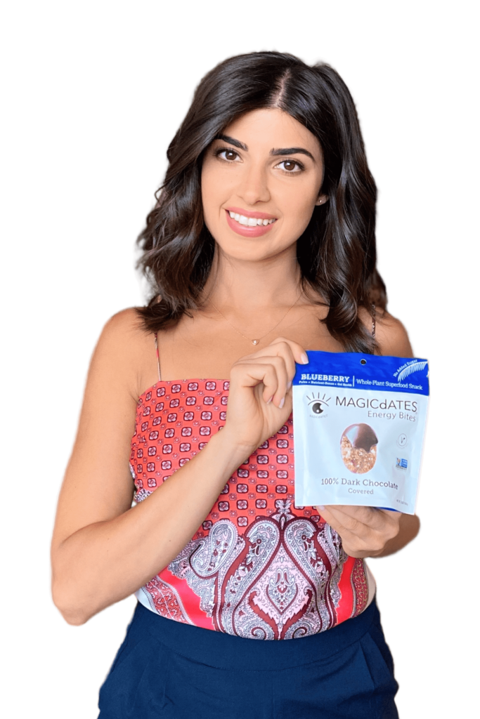 woman holding up a package of a product