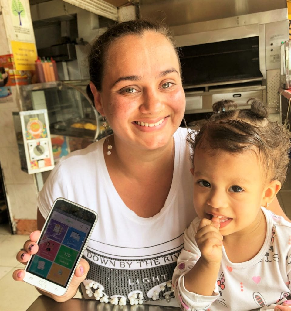 a woman and her son with a cell phone in colombia