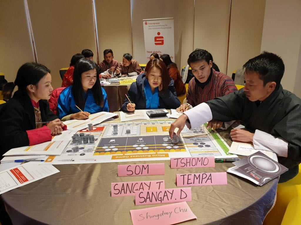 people playing a business game