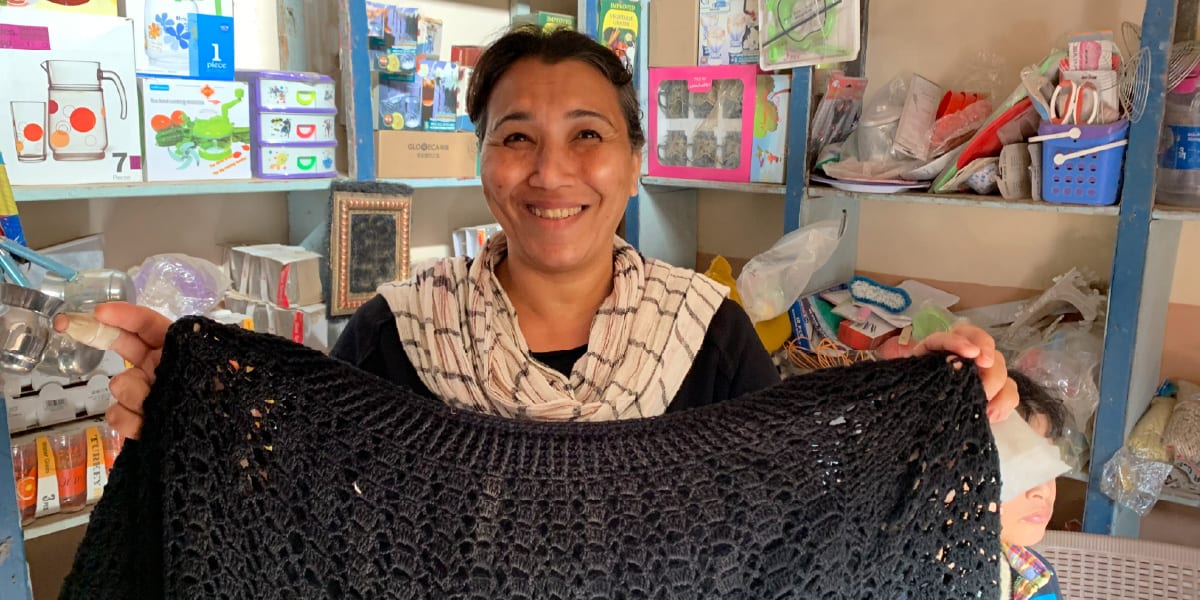 a microcredit client in her shop in egypt