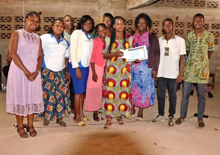 award recipient and staff of mfi in togo