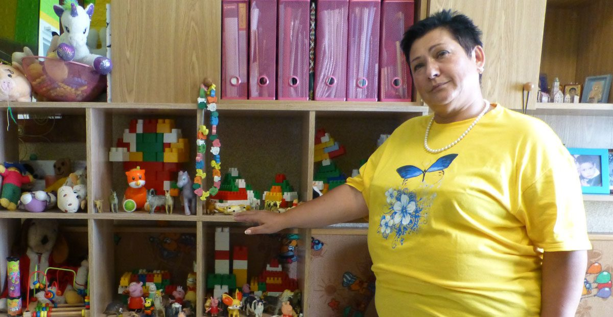 woman standing in front of toys and books